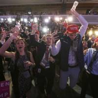 Supporters of U.S. Republican president-elect Donald Trump celebrate the results at his election night rally in Manhattan on Nov. 8. | REUTERS
