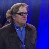Trump campaign chairman Steve Bannon watches Nov. 5 as Republican presidential nominee Donald Trump speaks during a rally at the Reno-Sparks Convention Center in Reno, Nevada. Trump made the first top appointments of his new administration Sunday, naming Reince Priebus his White House chief of staff and Bannon as his chief strategist and senior counselor. | AFP-JIJI