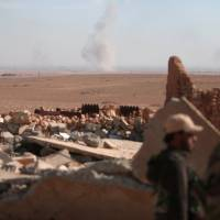 Syrian Kurds inch their way toward Raqqa, digging trenches to keep suicide car bombers at bay