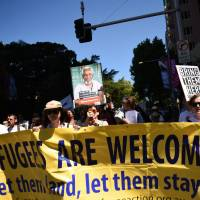 U.S. agrees to take in Australia-rejected refugees languishing on islands
