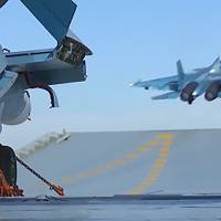An image grab taken from a video footage made available on the Russian Defense Ministry's official website on Tuesday reportedly shows a jet taking off from the Admiral Kuznetsov aircraft carrier in the eastern Mediterranean off the Syrian coast during a strike against Islamic State positions in Syria. | RUSSIAN DEFENSE MINISTRY / HO / AFP-JIJI