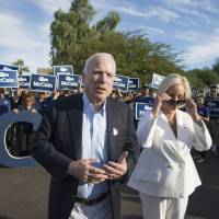 Sen. John McCain with his wife, Cindy McCain, talk to the media after casting their ballots at Mountain View Christian Church, in Phoenix, Arizona, on Election Day, Tuesday. | NICK OZA / THE ARIZONA REPUBLIC VIA AP