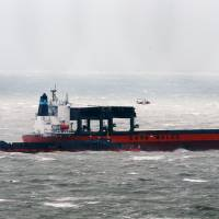 Freighter evacuated after hitting barge off England's storm-hit south shore