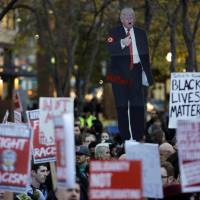 People gather in protest to the election of Republican Donald Trump as U.S. president in Seattle, Washington. | REUTERS