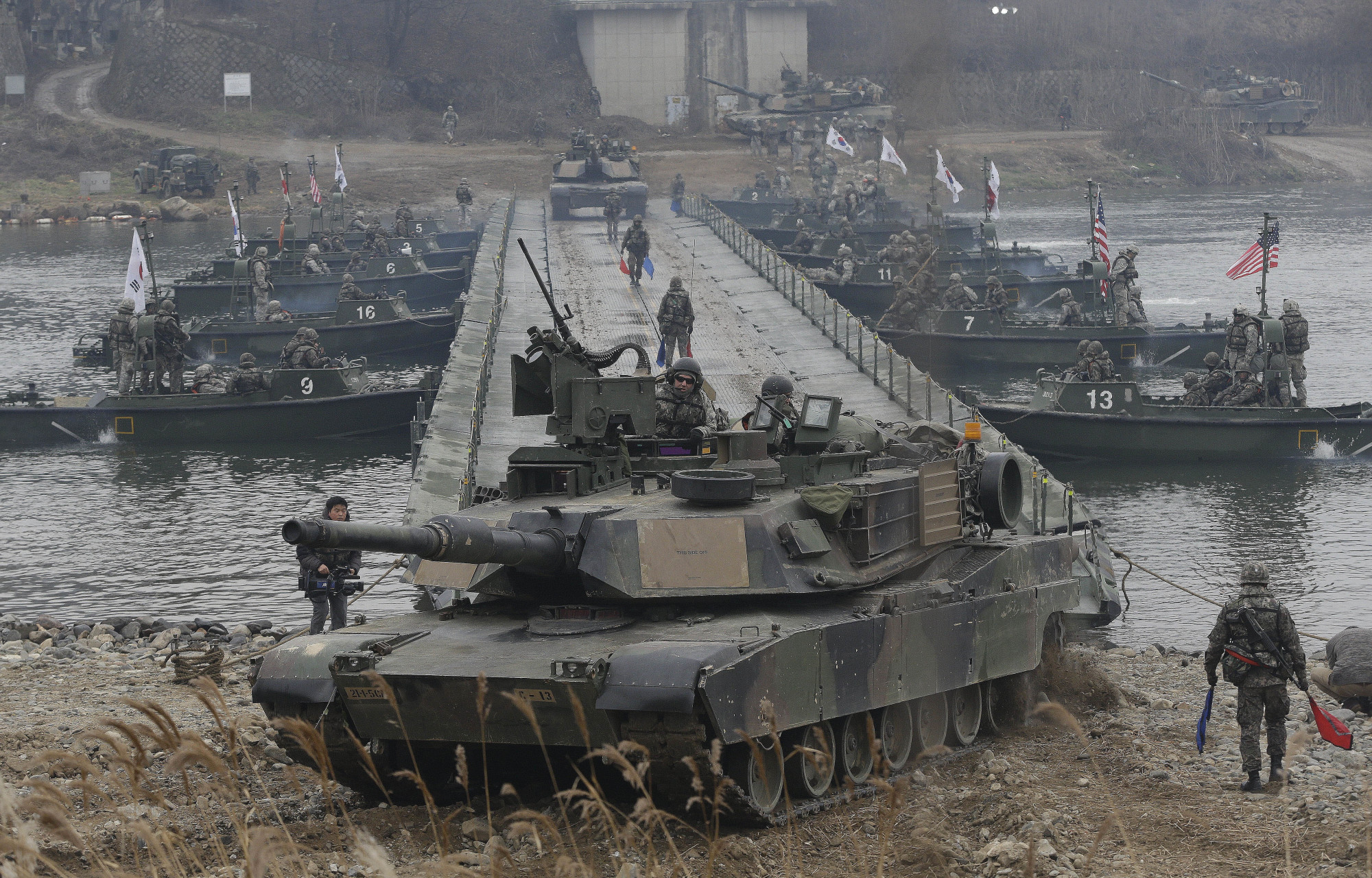 U.S. tanks cross the Hantan River during a river-crossing operation, part of an annual joint military exercise between South Korea and the United States against a possible attack from North Korea, in Yeoncheon, South Korea, last December. | AP