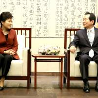 South Korean President Park Geun-hye talks with parliament Speaker Chung Sye-kyun during their meeting at the National Assembly in Seoul on Tuesday. | REUTERS