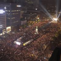 After protests, South Korea issues arrest warrants for two ex-presidential aides