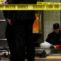 Woman pushes another to her death in front of subway train under Times Square