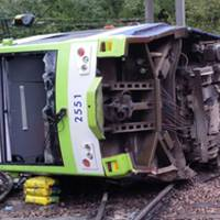 At least seven killed as London tram takes curve too fast, flips; motorman held