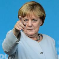 Trump poses daunting new challenge for Germany's Merkel