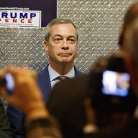 U.K. Independence Party leader Nigel Farage gets on an elevator at Trump Tower on Saturday in New York. | AP