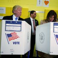 Republican U.S. presidential nominee Donald Trump and his wife, Melania, vote in New York on Tuesday. | REUTERS