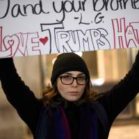 A woman protests the election of Republican Donald Trump as U.S. president in Philadelphia on Friday. | REUTERS