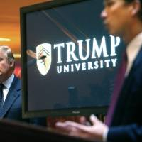 Real estate mogul and reality TV star Donald Trump listens as Michael Sexton introduces him at a 2005 news conference in New York, where he announced the establishment of Trump University. Trump is scheduled to go on trial this month in a class-action lawsuit against him and his now-defunct Trump University, potentially taking the witness stand weeks before his inauguration as president of the United States. | AP
