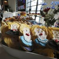 Cookies depict Hillary Clinton and Donald Trump at an election event at the U.S. Ambassador's residence in Tokyo. | AP PHOTO
