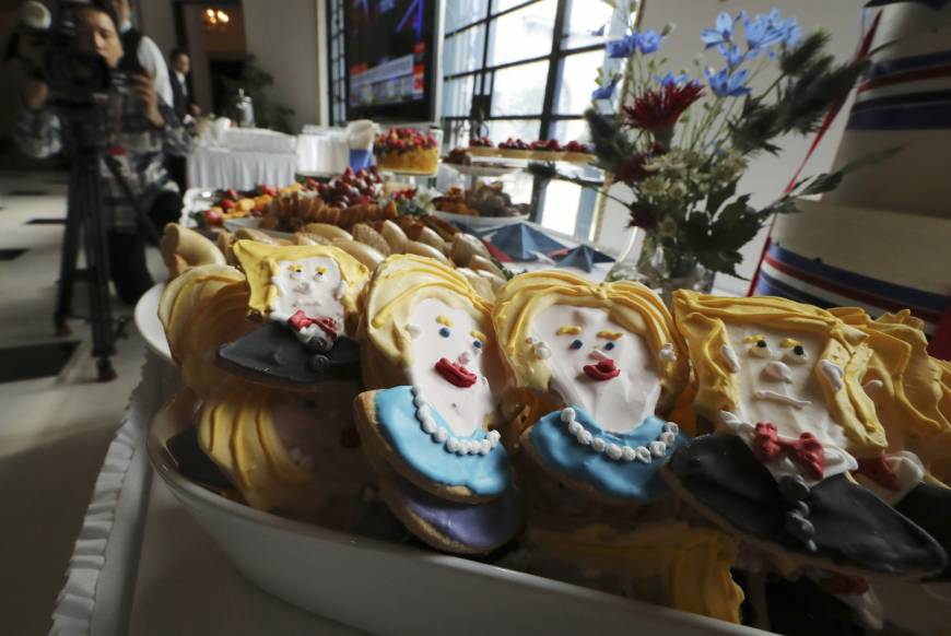 Cookies depict Hillary Clinton and Donald Trump at an election event at the U.S. Ambassador