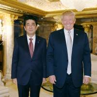 Prime Minister Shinzo Abe poses for a photograph with U.S. President-elect Donald Trump in New York on Nov. 18. | CABINET SECRETARIAT/ VIA AFP-JIJI