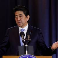 Prime Minister Shinzo Abe holds a news conference in Buenos Aires on Monday. | REUTERS