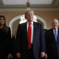 President-elect Donald Trump and his wife, Melania, walk with Senate Majority Leader Mitch McConnell on Capitol Hill in Washington on Thursday. | AP