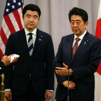 Prime Minister Shinzo Abe gestures during a press conference after his meeting with U.S President-elect Donald Trump on Thursday in New York. | AFP-JIJI