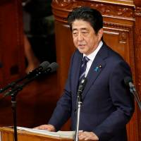 Prime Minister Shinzo Abe gives an address at the start of the Diet session at the Lower House in Tokyo on Sept. 26. | REUTERS