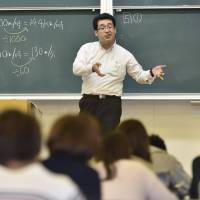 Takanobu Kameda, who helps university students with development disorders, lectures on job-hunting at Setsunan University in Neyagawa, Osaka Prefecture. | KYODO