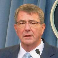 Visit by U.S. defense chief to finalize immunity pact could come early next month