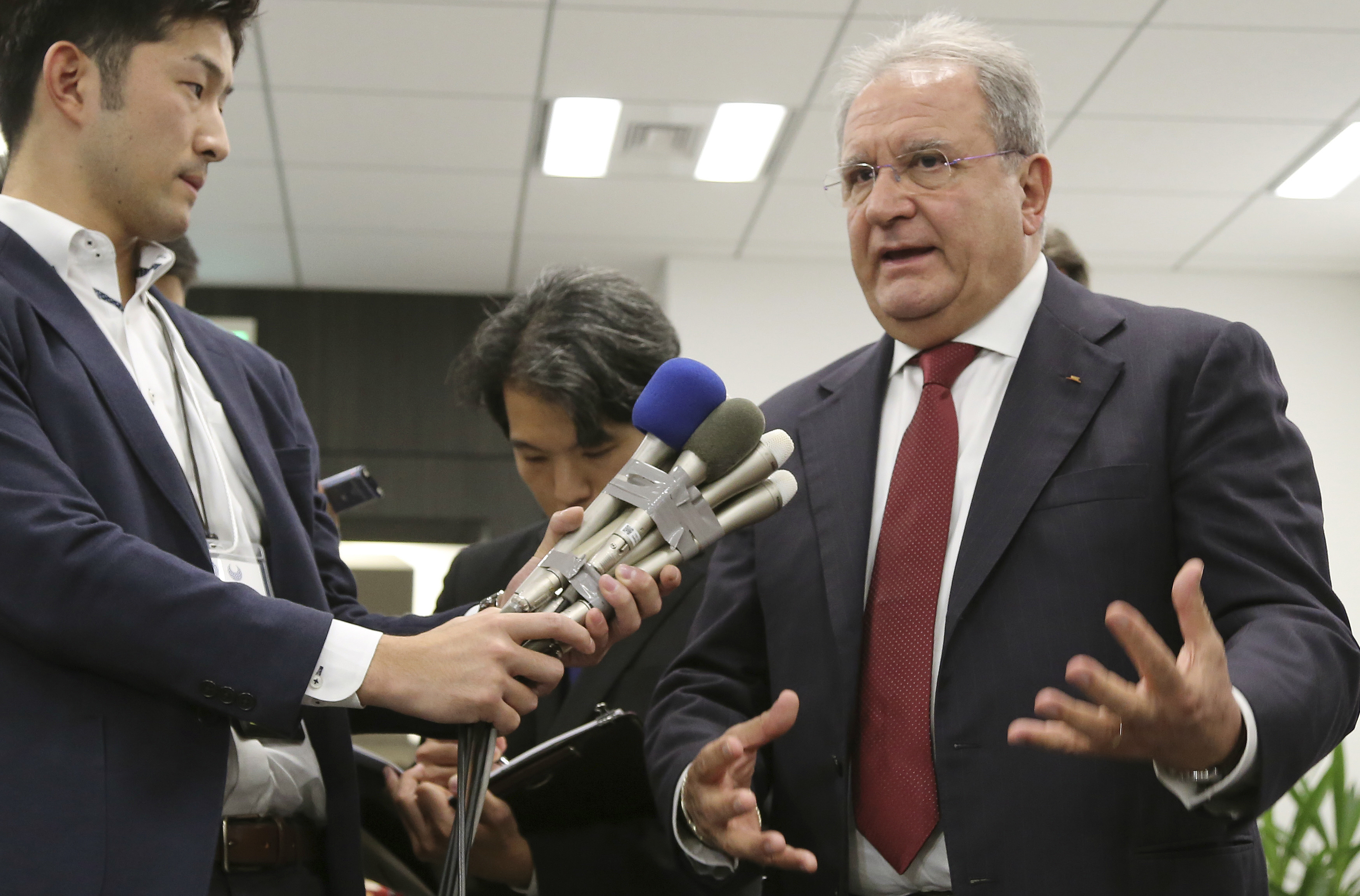 The president of the World Baseball Softball Confederation Ricardo Fraccari at press conference in Tokyo on Friday. | AP