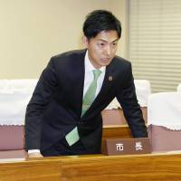 Mayor Hiroto Fujii tells the Minokamo Municipal Assembly on Monday that the Nagoya High Court has overturned his acquittal in a bribery case. | KYODO