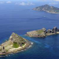 The Senkaku Islands in the East China Sea are seen from the air in 2012. The Self-Defense Forces, Coast Guard and police conducted a joint drill last week to fend off illegal entry of armed fishermen on a remote island. | KYODO