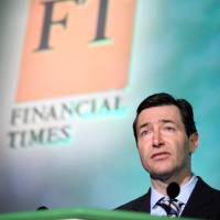 John Ridding, chief executive officer of the Financial Times, speaks at the Digital Media and Broadcasting Conference in London in March 2010. | BLOOMBERG