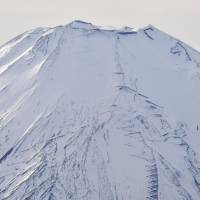 Mount Fuji is capped with ice and snow Sunday. | KYODO
