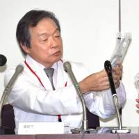 Takeyoshi Sata, head of the Hospital of the University of Occupational and Environmental Health in Fukuoka Prefecture, briefs reporters in October about holes found in IV bags. The hospital revealed a similar incident occurred Sunday. | KYODO