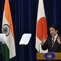 Indian Prime Minister Narendra Modi and Prime Minister Shinzo Abe hold a news conference at Abe's office in Tokyo Friday. | AP