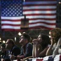 Supporters of Democratic presidential nominee Hillary Clinton watch and wait at her election night rally in New York on Nov. 8. | REUTERS