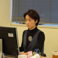 Kanae Doi, Japan director of Human Rights Watch, works at her office in Tokyo on Oct. 26. | KYODO