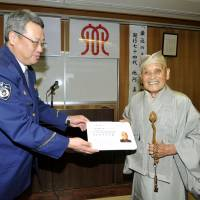 Buddhist priest sets example, surrenders license amid controversy over elderly driving