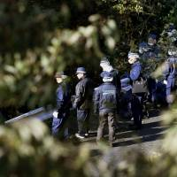 Police search for the body of a missing 4-year-old who was allegedly abandoned by his father about three years ago in the mountains of Gose, Nara Prefecture, on Friday. | KYODO