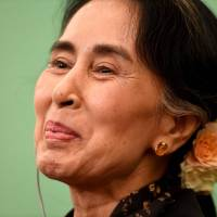 Myanmar State Counselor and Foreign Minister Aung San Suu Kyi smiles at a press conference at the Japan National Press Club in Tokyo on Friday. | AFP-JIJI