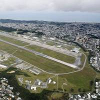 The U.S. Marine Corps Air Station Futenma sits in Ginowan, central Okinawa Prefecture. Locals against the base hope U.S. president-elect Donald Trump will abort controversial relocation plans. | KYODO