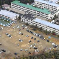 Evacuees park their cars on a school's grounds in Iwaki, Fukushima Prefecture, after a tsunami warning was issued Tuesday morning. | KYODO