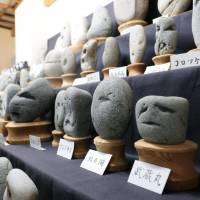 Rocks that look like human faces are seen on display at Chichibu Chinsekikan (Chichibu Museum of Rare Rocks) in Chichibu, Saitama Prefecture, on Oct. 25. | KYODO