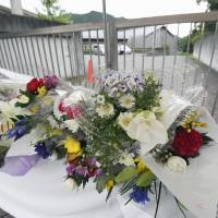 Floral tributes are seen in front of Tsukui Yamayuri En in Sagamihara, Kanagawa Prefecture, on Sept. 14.   KYODO