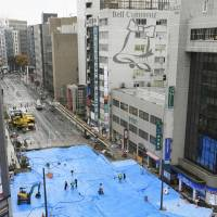 Utilities knocked out by huge Fukuoka sinkhole restored
