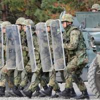 Ground Self-Defense Force personnel practice rescuing U.N. workers ahead of their deployment to South Sudan during a training session in Iwate Prefecture last month. | KYODO