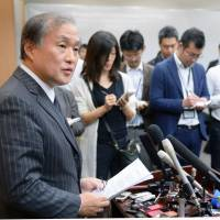 Deputy Foreign Minister Takeo Akiba speaks to reporters after meeting with his Chinese coutperpart on Tuesday in Beijing. KYODO