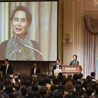 De facto Myanmar leader Aung San Suu Kyi speaks to people from Myanmar who are living in Japan on Wednesday morning at a Tokyo hotel. | KYODO