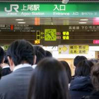 People line up at JR Ageo Station in Saitama Prefecture on Friday morning after a damaged cable halted all train operations on the JR Takasaki Line. | KYODO