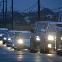 A traffic jam is observed in Iwaki, Fukushima Prefecture, at 6:32 a.m. Tuesday as people try to flee after a tsunami warning was issued. | KYODO