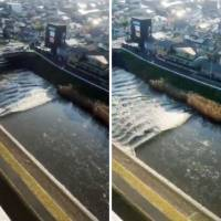 Tsunami waves are seen traveling back up the Sunaoshi River in Tagajo, Miyagi Prefecture, on Tuesday morning in a series of photos uploaded on Twitter. | KYODO